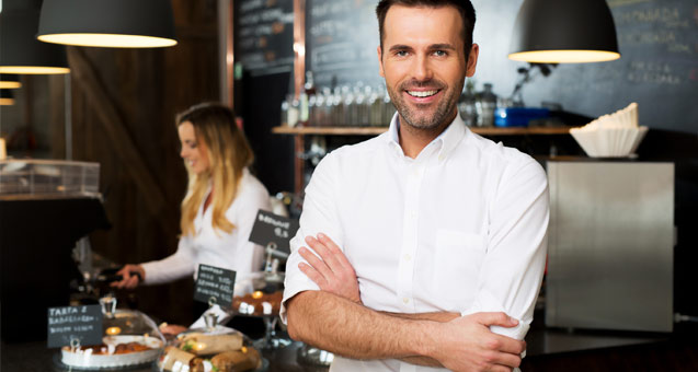 Smiling chef with arms folded across his chest